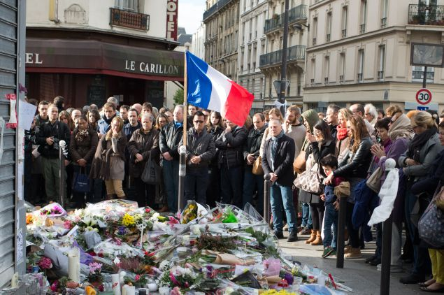 PARIS, FRANCE - NOVEMBER 16:  People gather to observe a minute silence outside the Le Carillon restaurant
